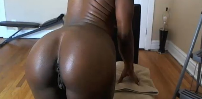 Oil on her tits and showing her chocolate pussy